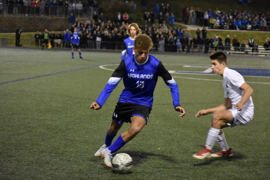 Junior Caymon Stevie dribbles the ball during the state semi-state game on October 23.