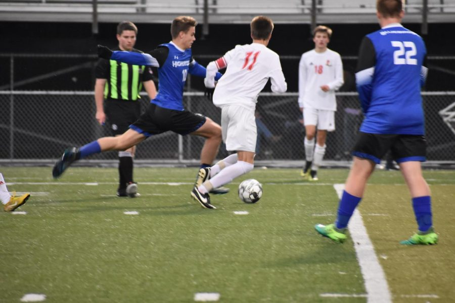 Senior Carter Holmes dribbles the ball down the field trying to score another goal.