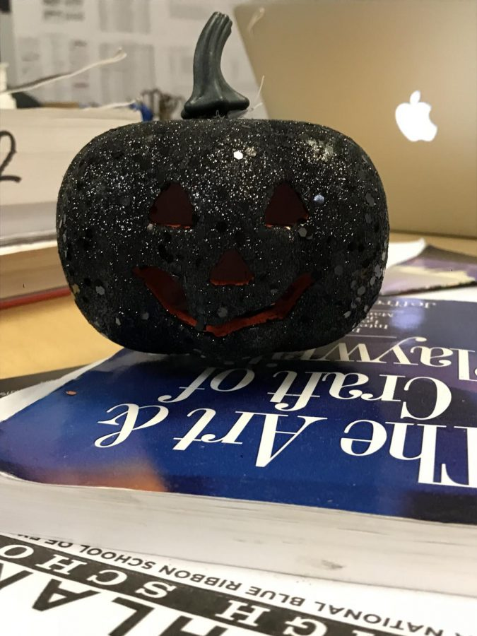 Pumpkin decoration in Mr. Burgess's room on his desk.