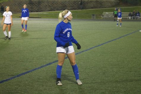 Senior Gwen Gorman prepares for the upcoming match between Highlands High School and the Boone County Rebels.