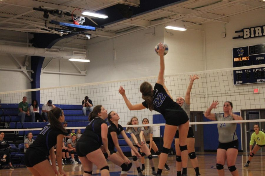 Sophomore Laura Winkler on September 6th, spikes the ball to Walton Verona's side and scores a point with a kill.