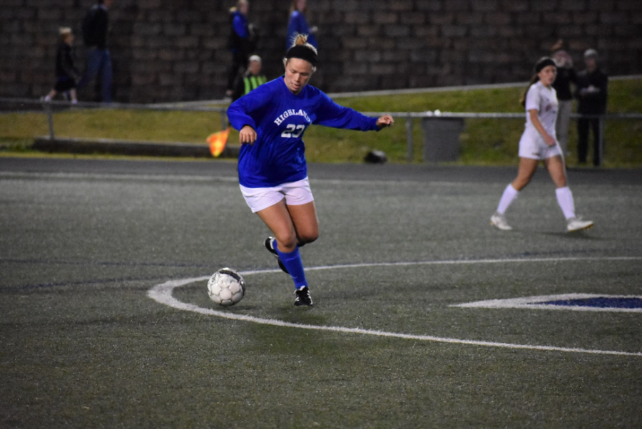 Sophomore Maggie Stieby goes for the ball in the state semi-match against George Rogers Clark on October 22.