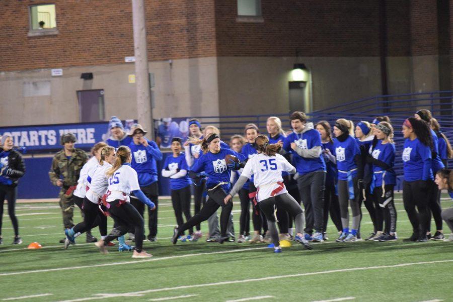 Senior Hannah Hartman runs with the ball, evading the juniors.