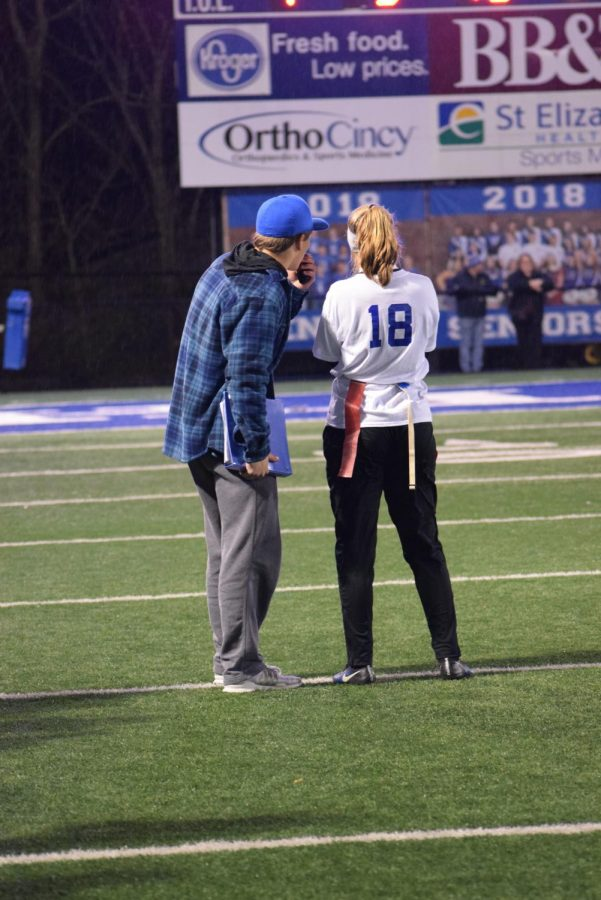 Junior Maggie Hinegardner gets advice from her coach on what play to run next.