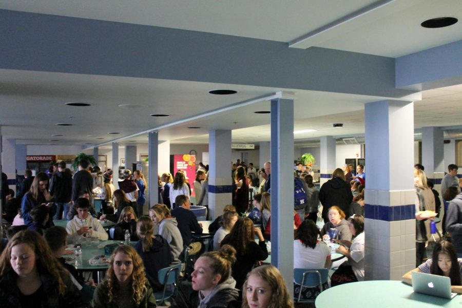 Students fill the cafeteria, eating their lunch of Marco's pizza and Skyline coneys.