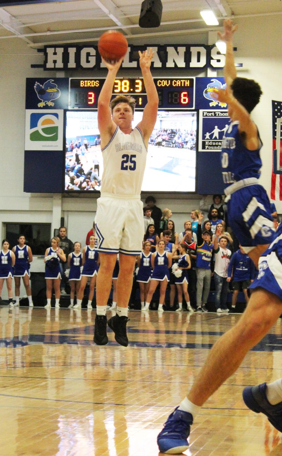 Senior Will Salmon shoots a jump shot, putting the defense off balance
