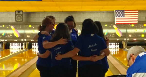 Girls huddle up before the match to get ready to play. Photo: Tristin Brubaker