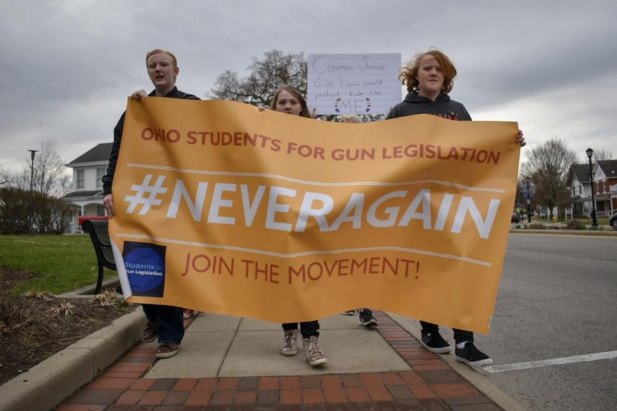 Members+of+Students+For+Gun+Legislation+lead+the+march+with+their+%23NeverAgain+banner.