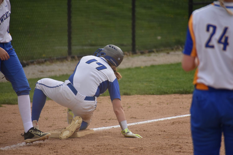 Freshman Gracie Schlosser sliding to 3 rd base