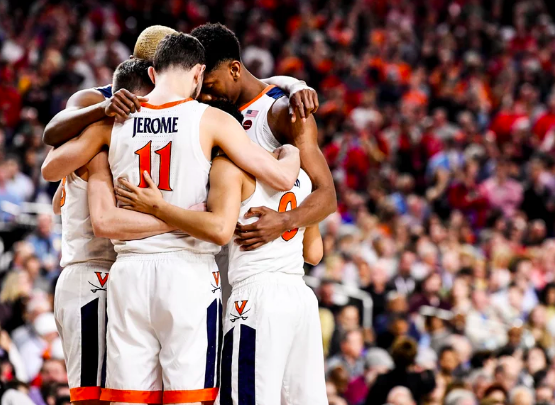 Picture from Sports Illustrated- The Virginia basketball team bands together, hoping for a great game.