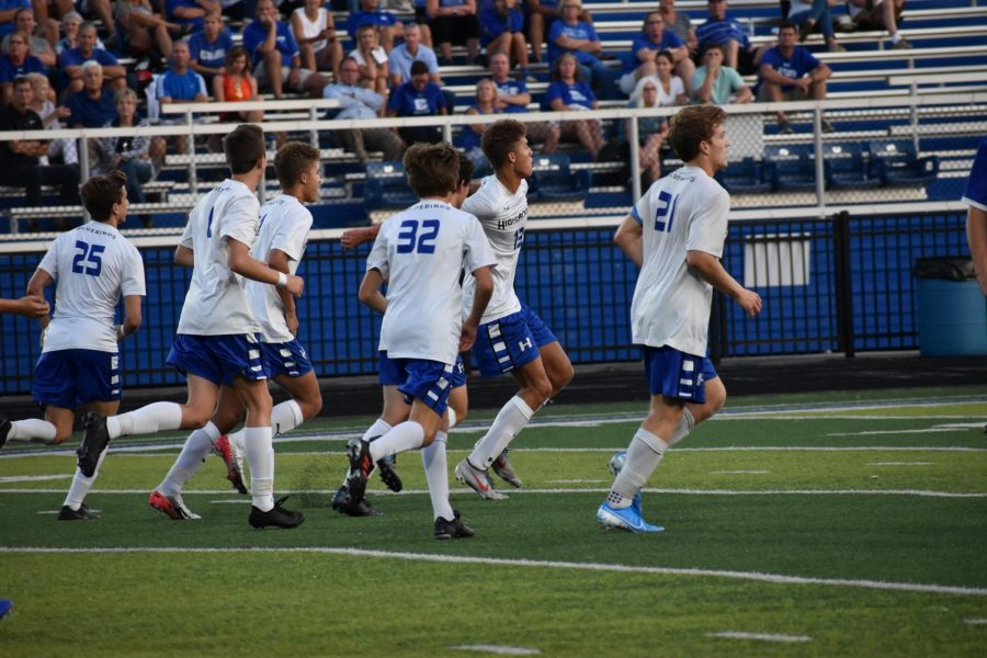 The+HHS+Boys+Varsity+soccer+team+rushed+to+get+into+their+defensive+positions.