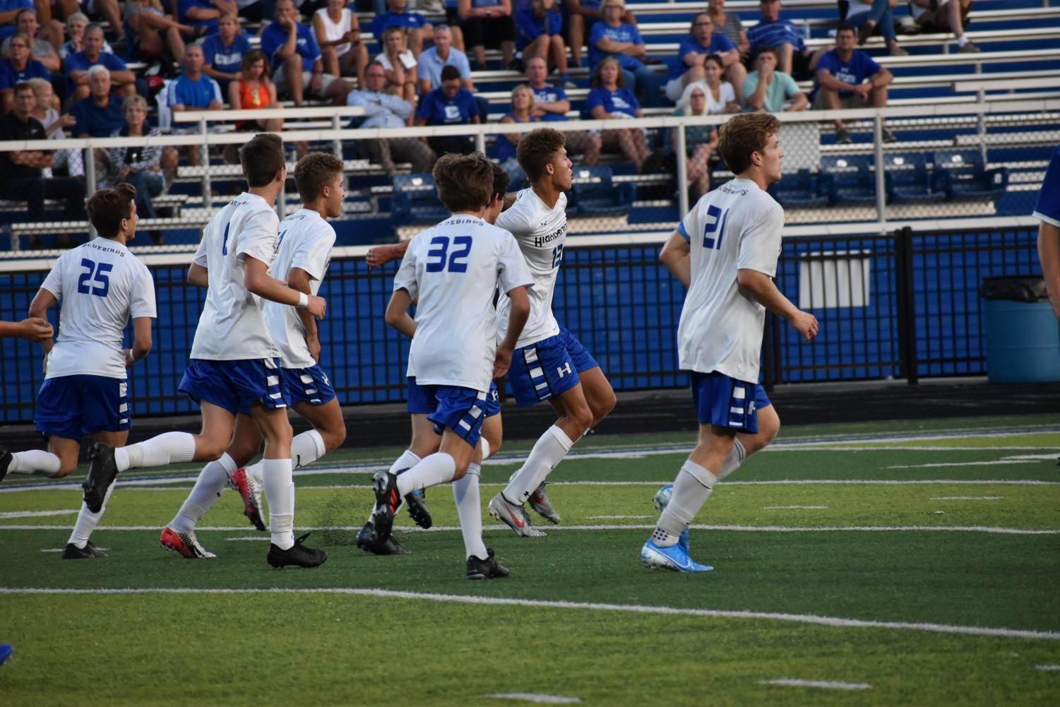 The HHS Boys Varsity soccer team rushed to get into their defensive positions.
