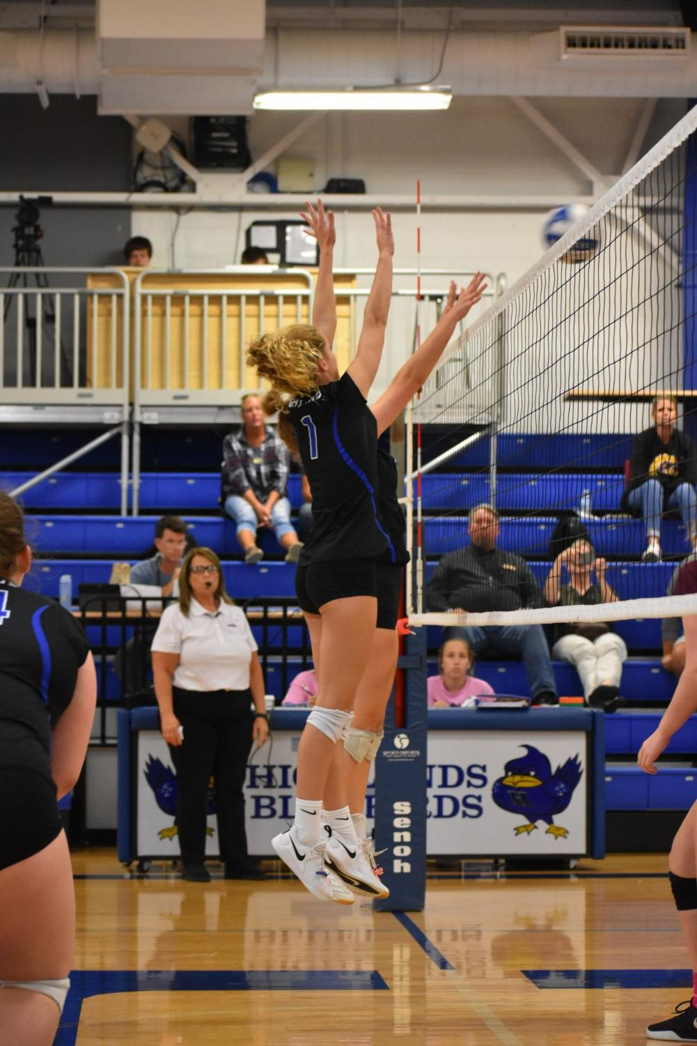 Sophomore Lilly Koenig blocks the ball.