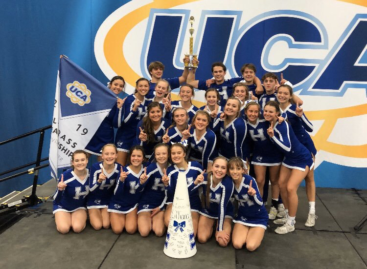 The+Varsity+Coed+Competition+Cheer+team+poses+for+a+picture+after+the+victory.+