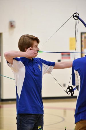 Junior Liam Kinnaird shoots for the target.