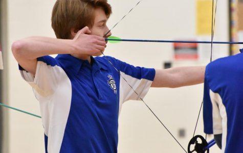Junior Liam Kinnaird shoots for the target.