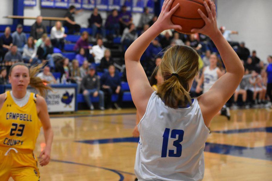 Senior+Maggie+Hinegardner+prepares+to+pass+the+ball.+