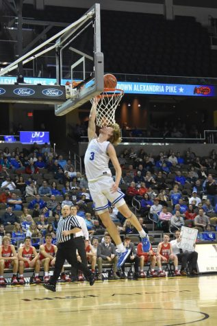 Junior Sam Vinson jumps to make a basket.