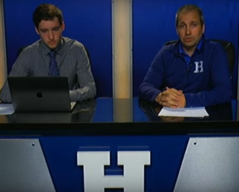 Principal+Matthew+Bertasso+and+Senior+Nick+Fischer+address+the+students+during+a+live+broadcast.