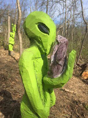An alien holding a rabbit!