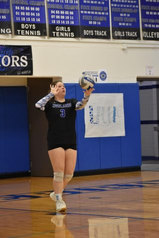 Senior Maria Little prepares to serve the ball.
