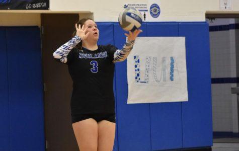 Senior Maria Little prepares to serve the ball.