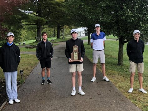 The Boys Golf Team sports their 8th Regional first place trophy.  Photo courtesy of HHS Boys Golf Team Twitter page (@HHSBlueBirdies).