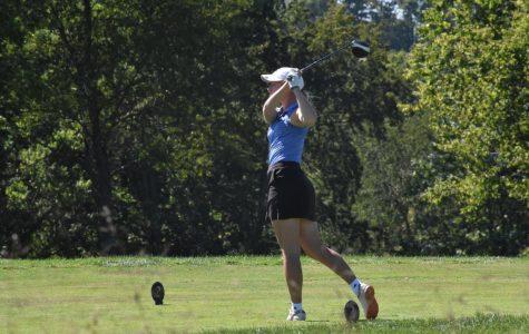 Senior Ellie Rowland takes a swing.