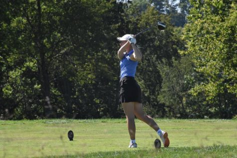 Senior Ellie Rowland takes a swing.