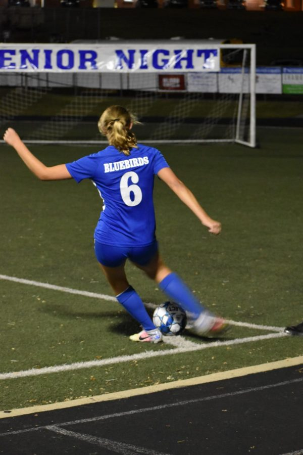 Junior Jade Rehberger signals to her teammates for a corner kick.