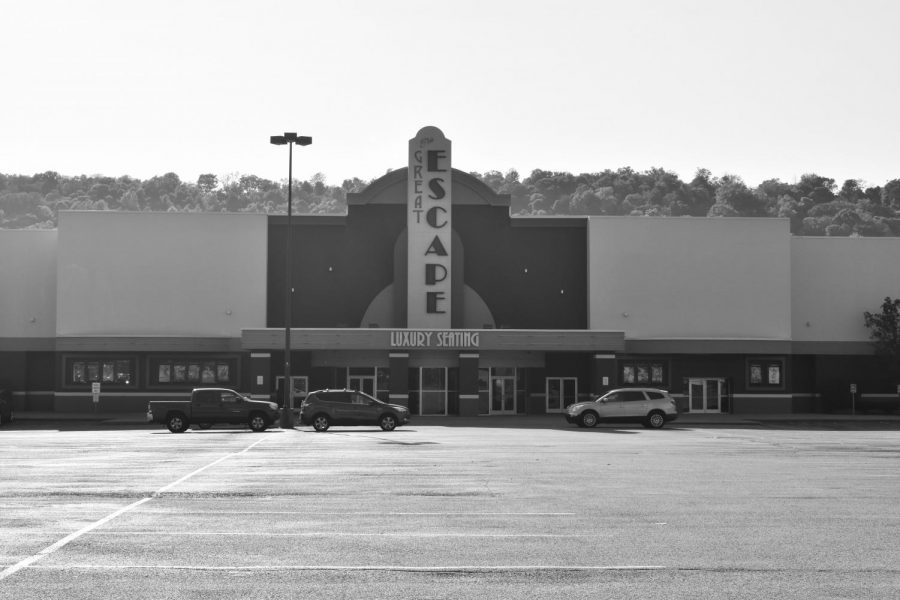 The Regal Wilder movie theatre's parking lot is empty, save for the cars of a few employees.