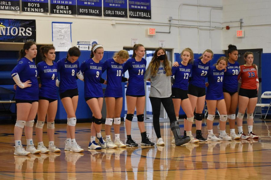 The Highlands varsity volleyball team stands together to recognize their seniors for the last home game of the season.