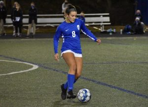 Senior Jordan Stuempel dribbles the ball down the field.