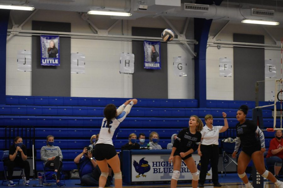 Junior Josie Steppe pops the ball back up, readying it to be set.