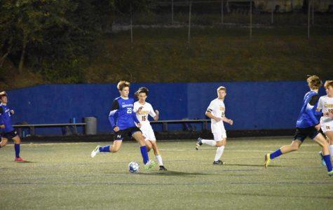 Senior Hank Cook makes a pass at a recent game vs Cooper High School.