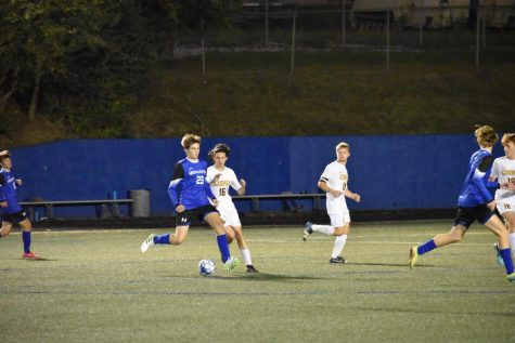 Senior Hank Cook makes a pass at a recent game vs Cooper High School.