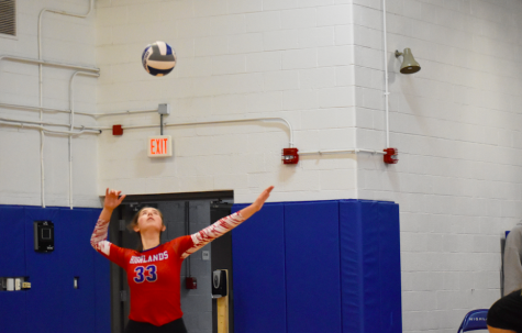 Junior Madison Clore serves to Holy Cross.