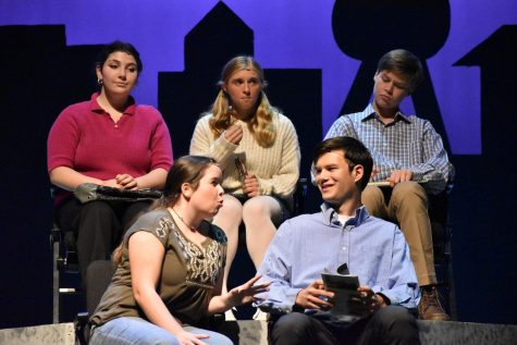 The audience (sophomores Sophia Veshapidze, Emma Cooper, Grace Shuley, and Alex Lacourt and freshman Jameson Zoller) discuss the first half of Middletown at intermission.
