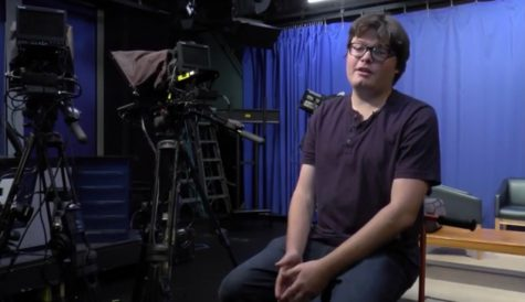 HHS Alumnus Chay Rust sits in the Highlands High School Broadcasting Studio that sparked his passion for film.