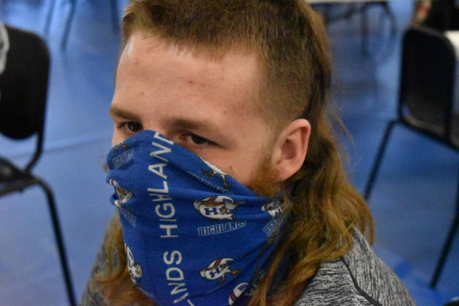 Junior Jacob Hudson shows off his mullet look that he has been growing out for a whole year.