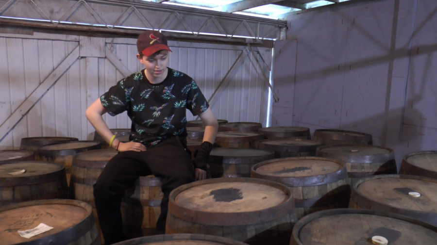 Bredwell sits on top of the extensive barrel collection in her warehouse.