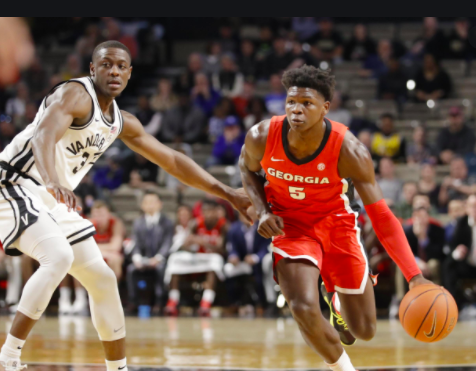 Anthony Edwards runs down the court while being guarded by a Vanderbilt player. (Bleacher Report - https://bleacherreport.com/articles/2905477-projecting-where-anthony-edwards-will-be-selected-after-2020-nba-draft-lottery)