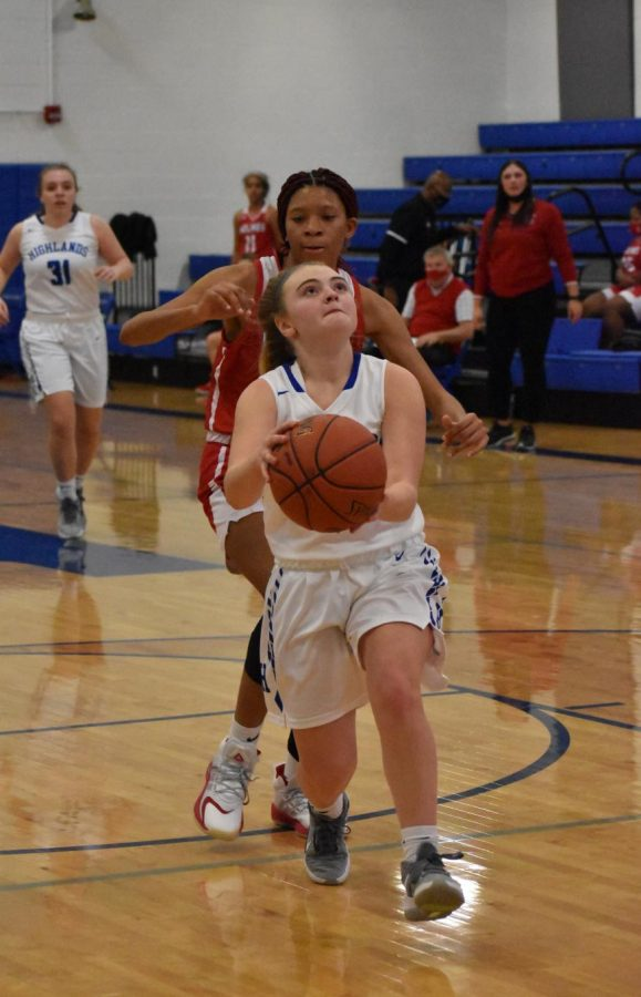 Senior Kate Vaught outruns her competitor, going in for a basket.