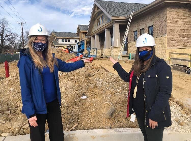 FTIS Superintendent Dr. Karen Cheser and Johnson Principal Ashley Dikeos pose with Johnson Elementary School, under construction.  Photo courtesy of Fort Thomas Independent Schools.