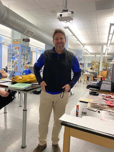 Teacher Andrew Eckerle runs the