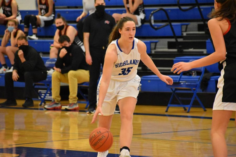 Senior Rory OHara dribbles up to her opponent ready to make a move. Additionally, OHara is running for The Cincinnati Enquirers Girls Basketball athlete of the week, so go out and vote!