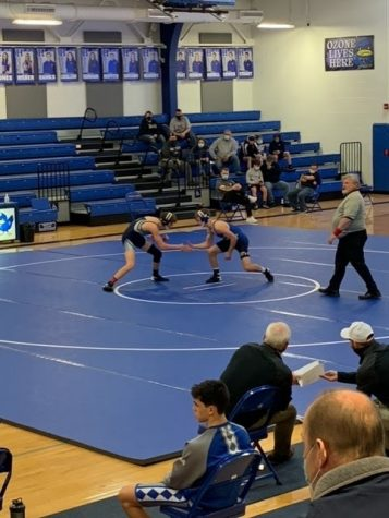 Senior Peter Laskey is seen competing against an opponent from Campbell County High School at their match last Sunday, February 14th.