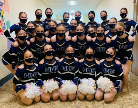 The Highlands High School varsity dance team poses for a picture before competition.