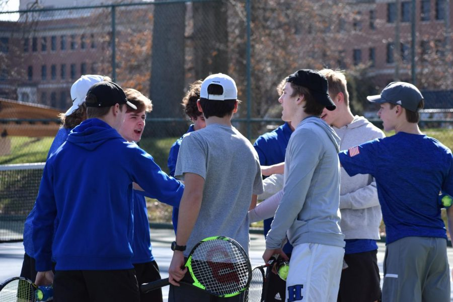 The team gathers before the matches start for a moment of camaraderie.