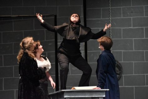 Igor (sophomore Grace Shuley) shows his excitement at the prospect of creating a monster in front of Inga (senior Zoe Zoller), Frau Blücher (senior Madi Burnett), and Dr. Victor Frankenstein (senior Hank Slaby).